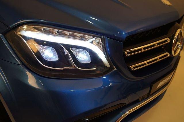 Электромобиль Mercedes-Benz GLS 63 AMG 4WD синий (2х местный, колеса резина, сиденье кожа, пульт, музыка)